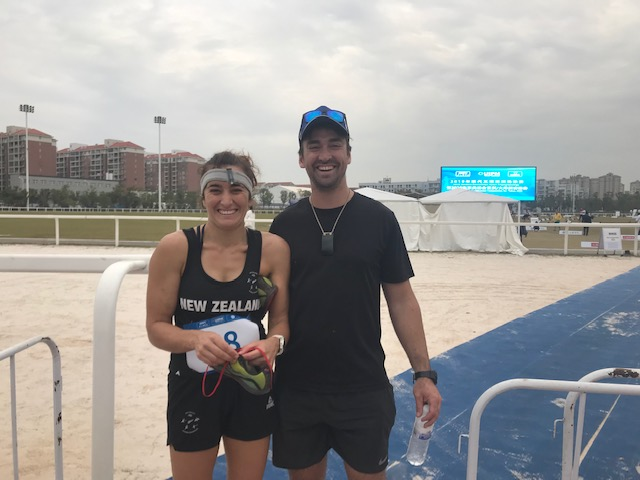 A thrilled Rebecca Jamieson with her husband Isaac, after winning the Oceania title in Wuhan, China.