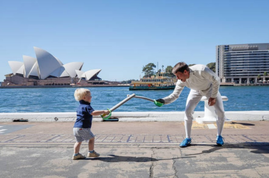 Edward Fernon plays with his son Lachlan during an AOC event on 14 April 14, 2021 in Sydney, Australia. (C) Hanna Lassen/Getty Images
